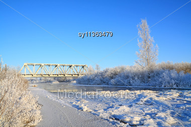 Railway Bridge On Freeze River Stock Photo