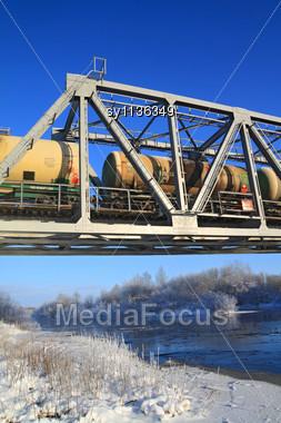 Railway Bridge Through Small River Stock Photo