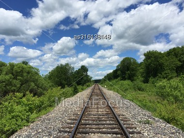 Railway To Horizon And Clouds On The Sky Background Stock Photo