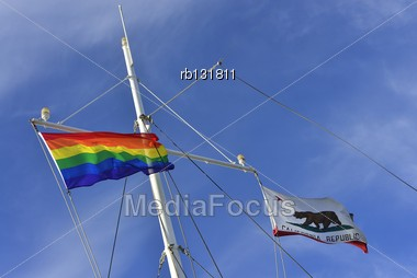 Rainbow Banner Flies Alongside The Banner Of California Republic On The Mast Of A Yacht Stock Photo