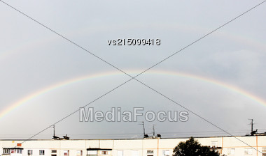 Rainbow Over House. Weather In City.Cloudy Sky With Rainbow. City Landscape With Rainbow And Clouds Stock Photo