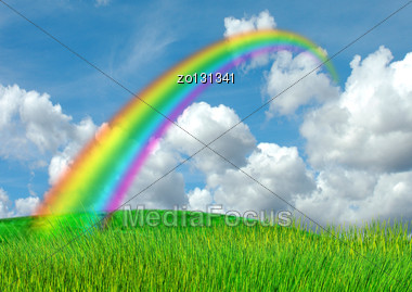 Rainbow In The Blue Sky Over A Glade Stock Photo