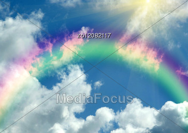 Rainbow In Clouds And In Blue Sky Stock Photo