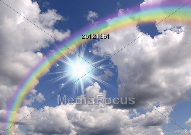 Rainbow In Clouds And To The Blue Sky Stock Photo