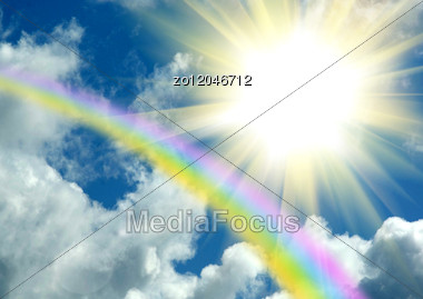 Rainbow And The Sun In Clouds In The Dark Blue Sky Stock Photo