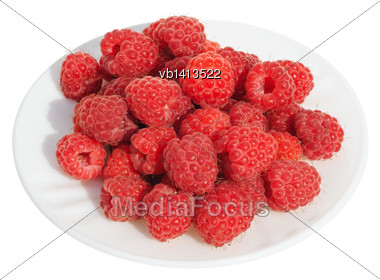 Raspberries On A White Plate On A White Background; Isolated Stock Photo
