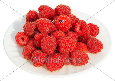 Raspberries On A White Plate On A White Background, Isolated Stock Photo