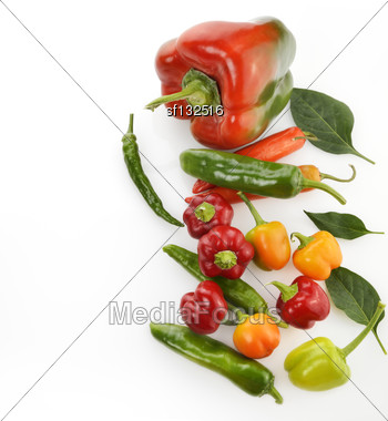 Raw Colorful Peppers On White Background Stock Photo