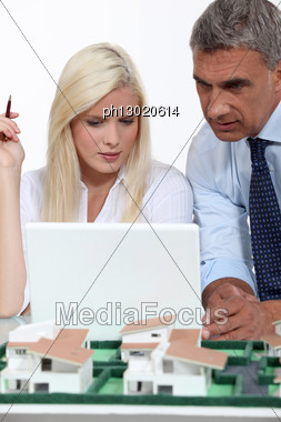 Real Estate Businessman And His Secretary Working Stock Photo