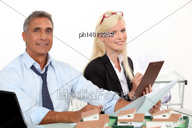 Real Estate Manager And His Assistant Stock Photo