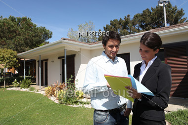 Realtors In Front Of A House Stock Photo