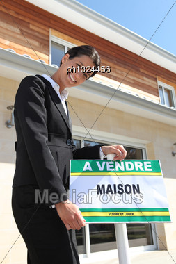 Realty Agent Leaning On Stock Photo