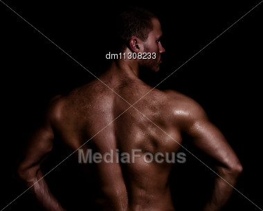 Rear View Of Young Muscular Man Stock Photo