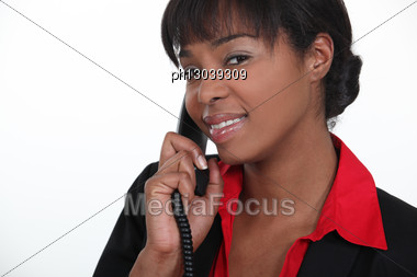 Receptionist Answering A Telephone Stock Photo