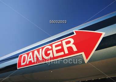 Red Arrow Labeled With Danger Stock Photo