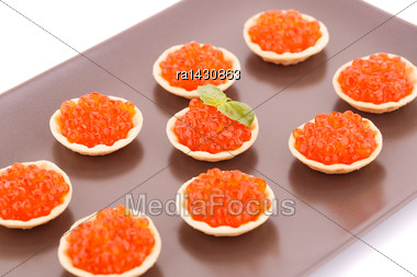 Red Caviar In Round Pastries On Brown Plate Stock Photo