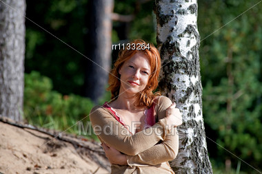 Red-haired Adult Woman In Dune Lean On Birch Stock Photo