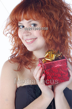 Red-haired Pretty Girl With Gift Stock Photo