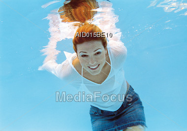 Royalty free stock photo red headed woman smiling underwater