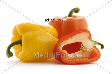 Red, Orange And Yellow Paprika Pepper On White Stock Photo