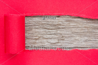 Red Paper Torn To Reveal Wooden Panel For Copy Space Stock Photo