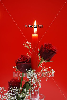 Red Roses and candle Stock Photo