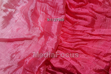 Red Silk Scarf Is Decorated And Fascinates Stock Photo