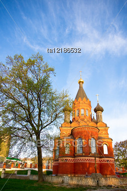 Red Stone Orthodox Church With Black Cupolas, Bryansk Region, Russia Stock Photo
