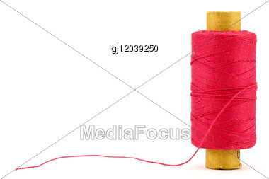 Red Thread Spool Stock Photo