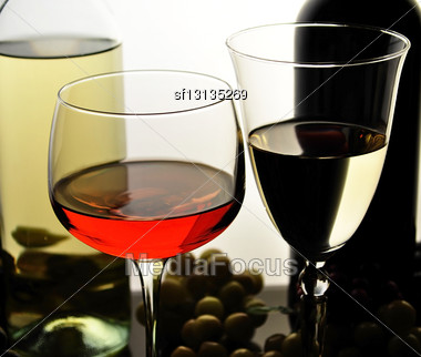 Red And White Wine Glasses And Bottles Stock Photo