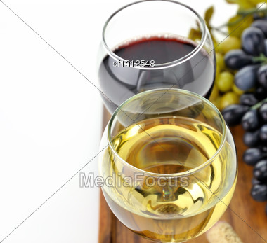 Red And White Wine Glasses With Grape Stock Photo