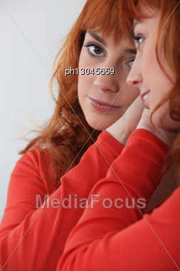 Redhead Looking In A Mirror Stock Photo