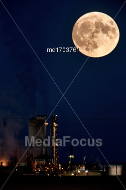 Refinery And Super Moon In Saskatchewan Night Stock Photo