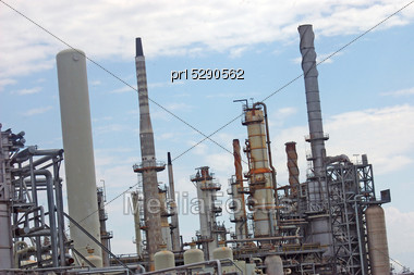 Refractory Towers At An Oil Refinery Stock Photo