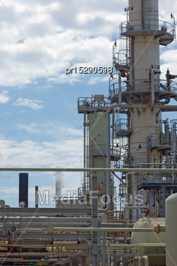 Refractory Towers At Oil Refinery Stock Photo
