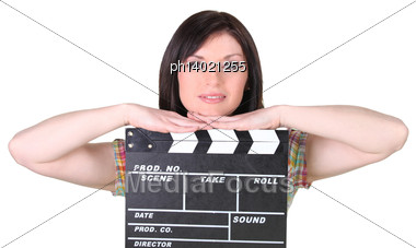 Relaxed Woman Leaning On A Cinema Clap On White Background Stock Photo