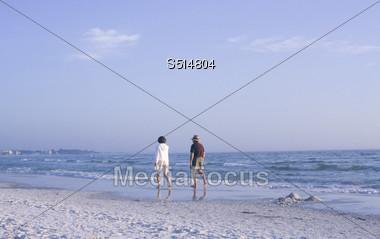 Relaxing Walk along the Beach Stock Photo