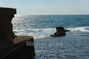 Remains Of Fortress Walls Of The Acre And The Mediterranean Sea Stock Photo