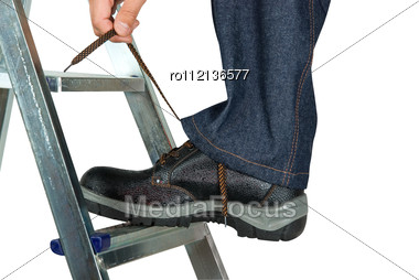 Repairman Lace His Shoes Stock Photo