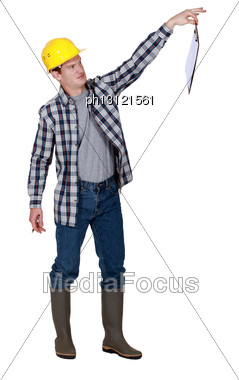 Repulsed Tradesman Dangling A Clipboard Stock Photo