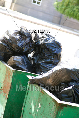 Residential Garbage Overflowing Trash Cans In The Street Stock Photo