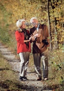Retired Couple Trail Walking Together Stock Photo