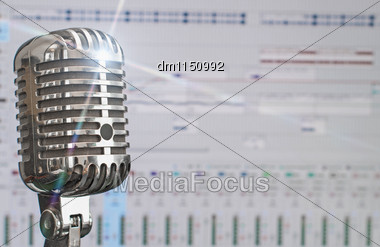 Retro Microphone Over Recording Software Background Stock Photo