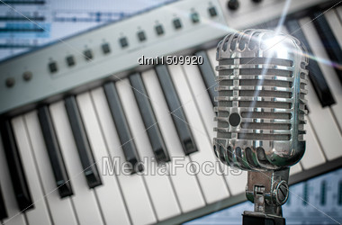 Retro Microphone Over Piano And Recording Software Background Stock Photo