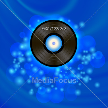 Retro Vinyl Disc On Blue Blurred Background Stock Photo