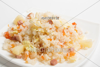 Rice With Vegetable On A Plate Isolated Over White Stock Photo