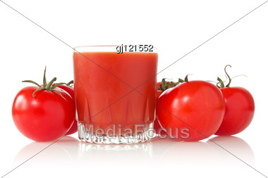 Ripe Tomatoes And Glass Of Tomato Juice Stock Photo