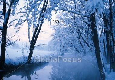 River In Winter Landscape Stock Photo