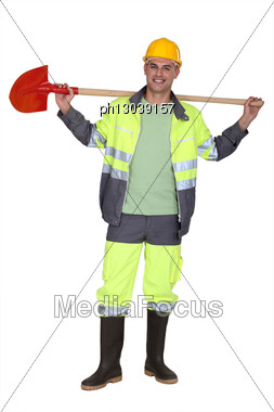 Road Worker Holding Shovel On His Shoulders Stock Photo