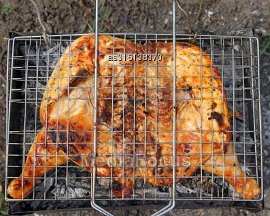 Roast Chicken On Grill Stock Photo